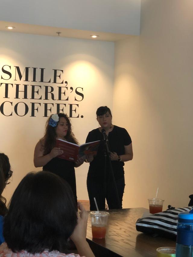 Photo of Aideed Medina and Marisol Baca sharing a bilingual poem at Readers for RAICES