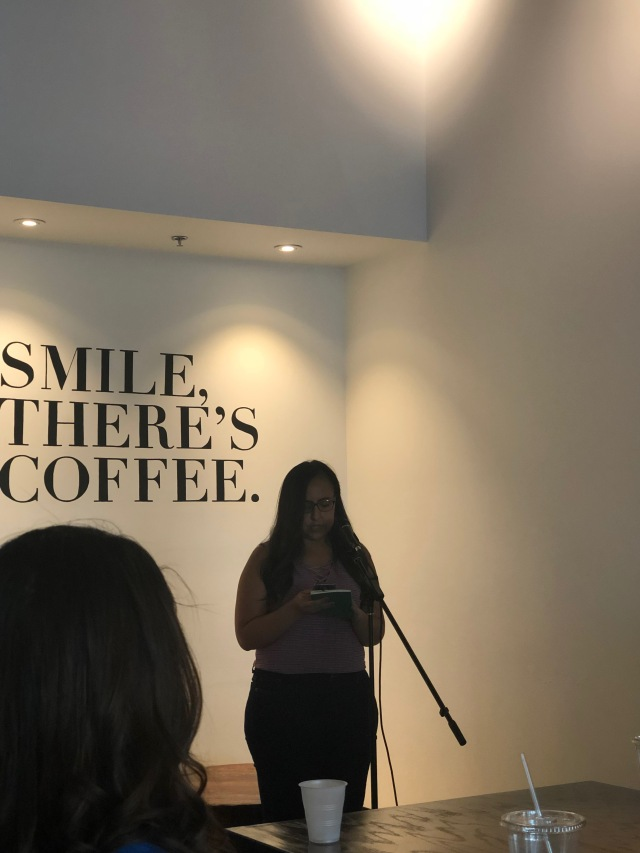 Photo of Emilia Mew reading at Readers for RAICES
