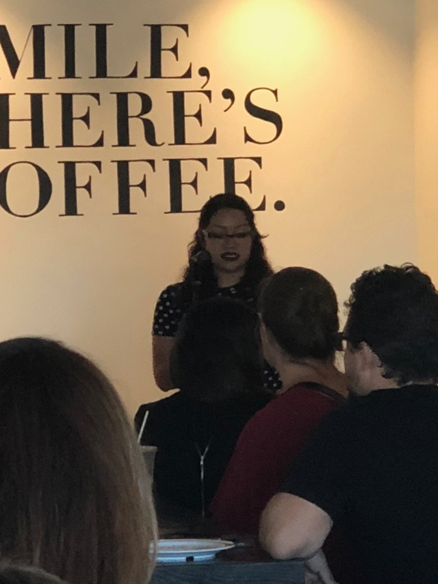 Photo of Esmeralda Gamez reading at Readers for RAICES