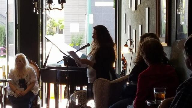 Photo of Jackie Huertaz reading at LitHop 2017