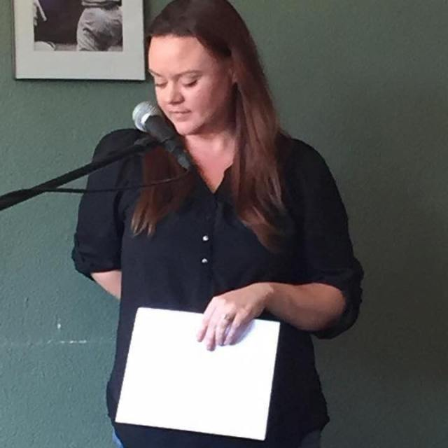 Photo of Melanie Kachadoorian emceeing the Fresno Women Read event at LitHop 2017