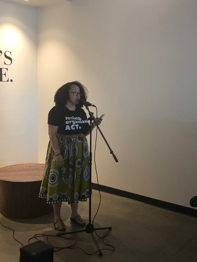 Photo of Jamie Moore reading at Readers for RAICES