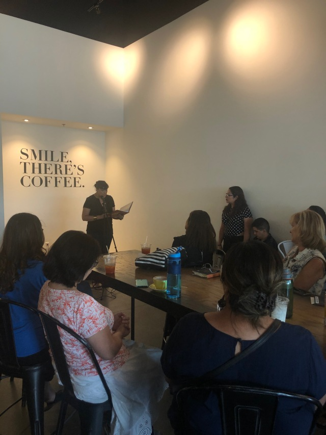Photo of Marisol Baca reading at Readers for RAICES