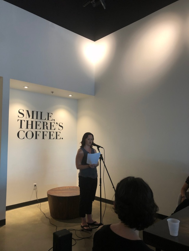 Photo of Melanie Kachadoorian reading at Readers for RAICES