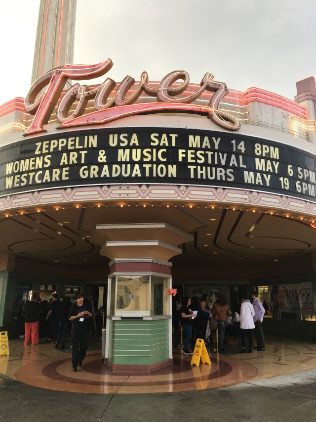 Photo of the Tower Theatre Marquee listing the First Annual Women's Art and Music Festival
