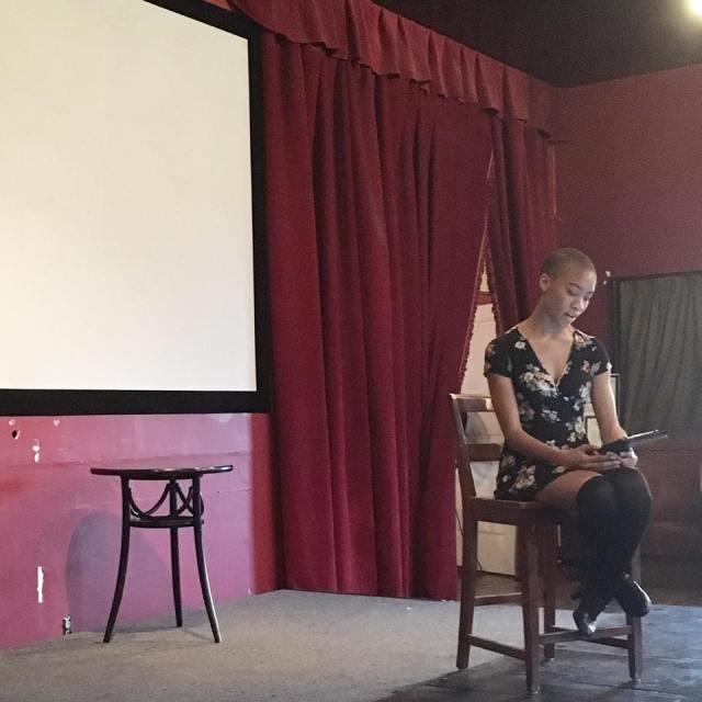 Photo of fiction writer Arielle Jones reading her work for Fresno Women Read's Rising Action reading