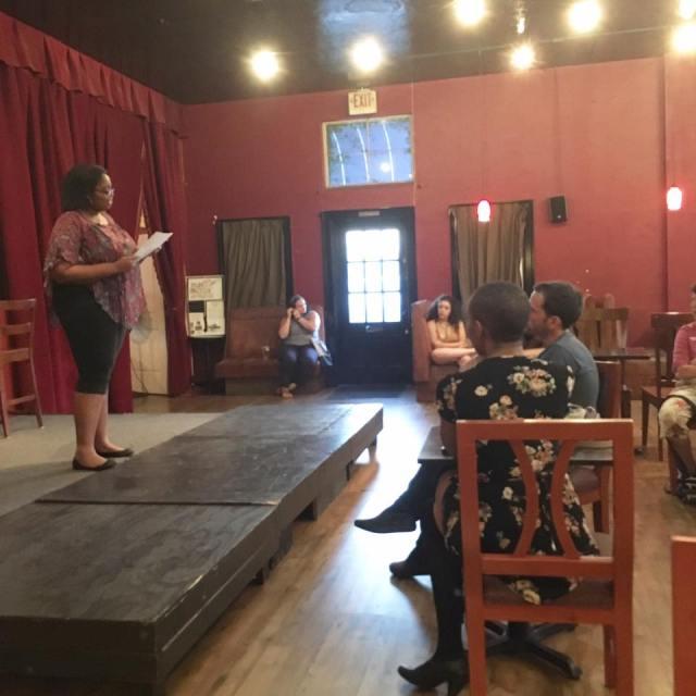 Photo of fiction writer Kamilah Okafor reading her work for Fresno Women Read's Rising Action reading