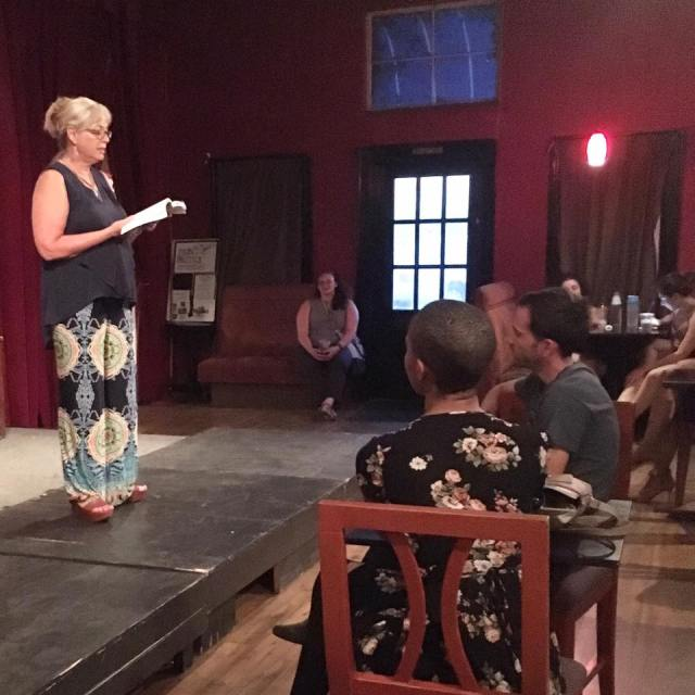 Photo of novelist Tanya Nichols reading from her new novel for Fresno Women Read's Rising Action reading