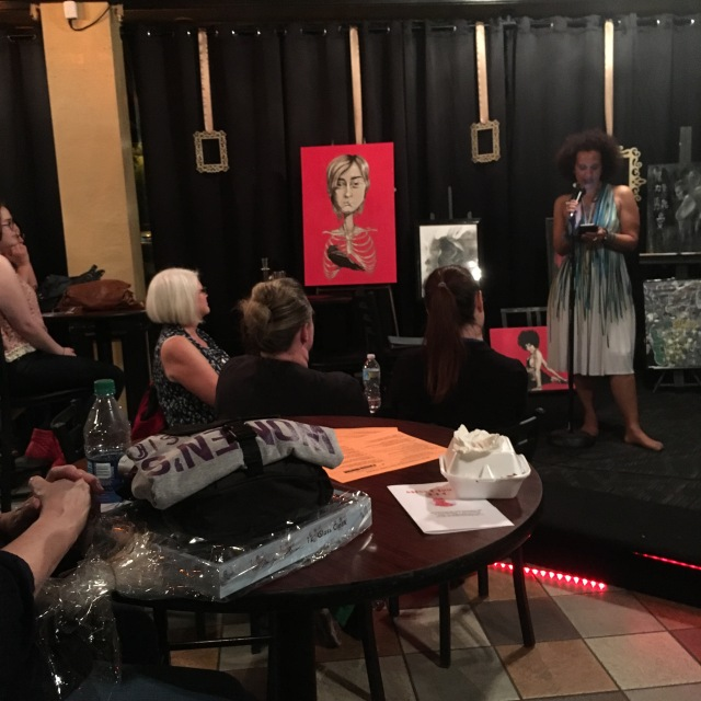 Photo of Melissa Knight sharing her work during open mic at WAMFF 2016