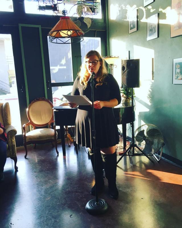 Photo of Angela Corbett reading