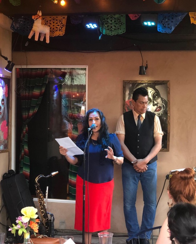 Photo of Teresa Chacon reading at the Cenote City book launch