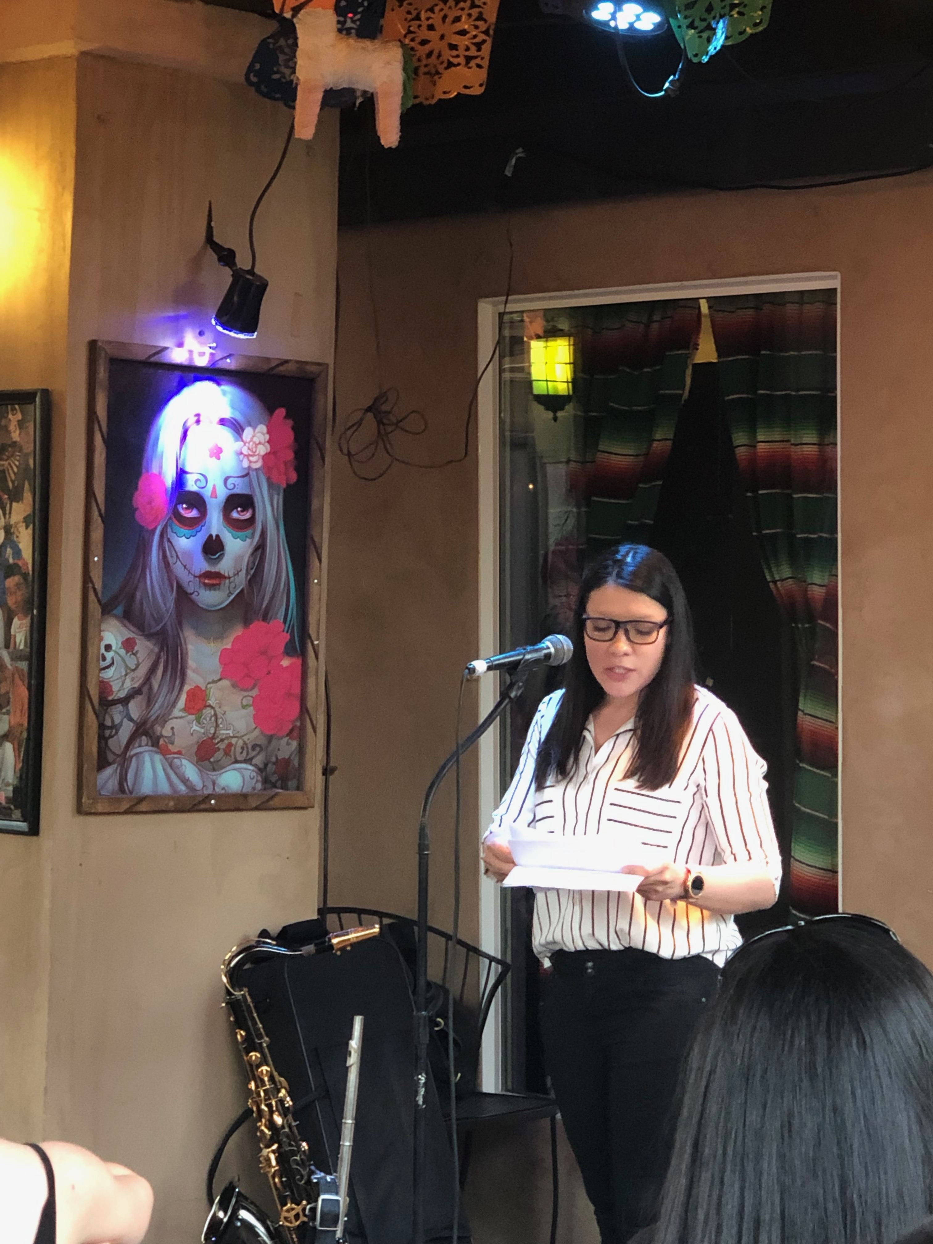 Photo of Jessica Santillan reading at the Cenote City book launch