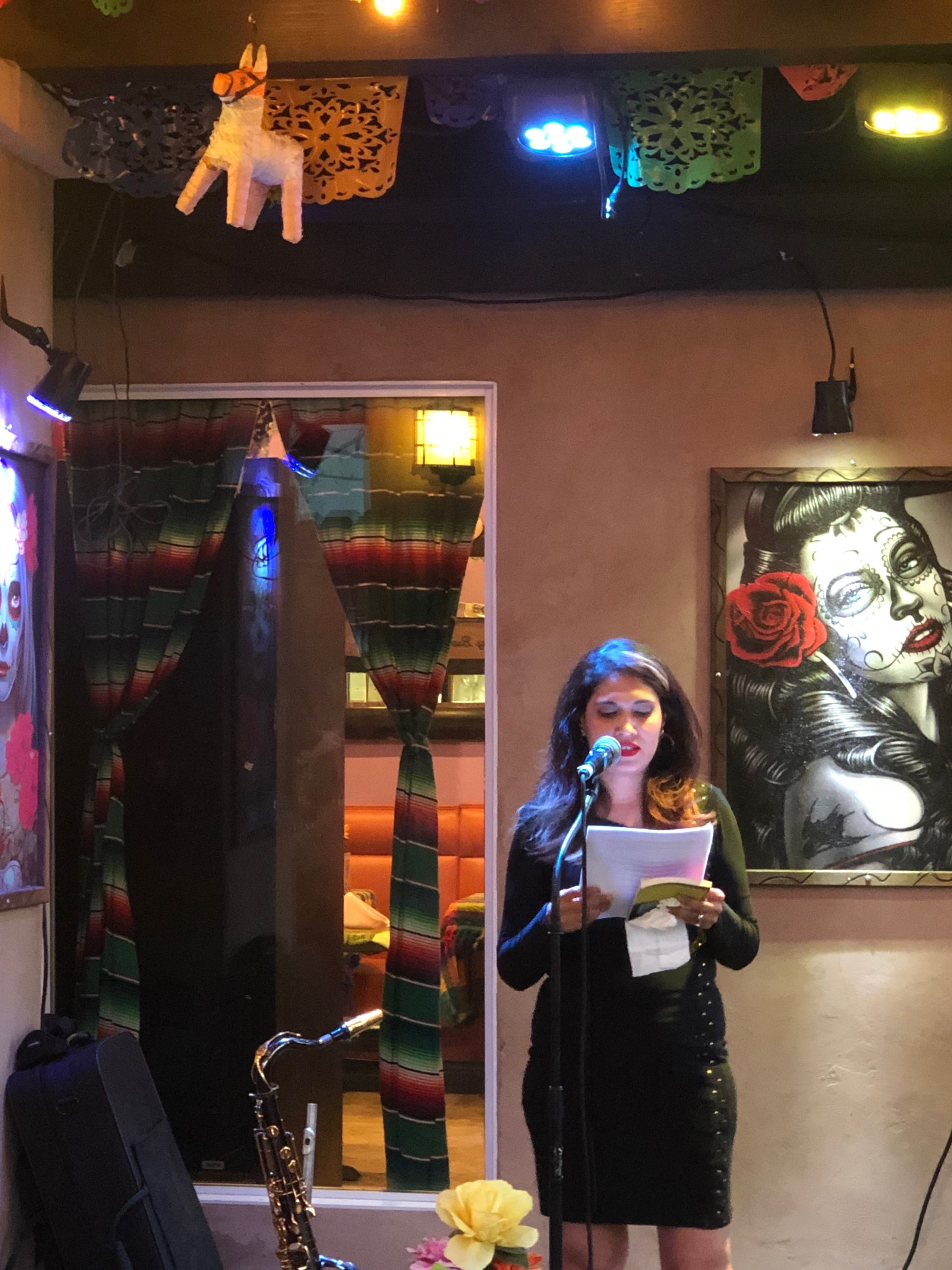 Photo of Monique Quintana reading at the launch party for her new book, Cenote City